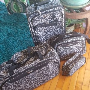 Tag luggage 4 piece set cheetah print black tan